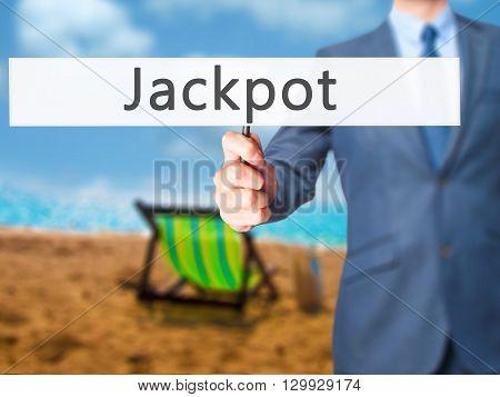 Jackpot - Businessman Hand Holding Sign