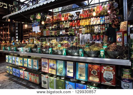 TEL AVIV, ISRAEL - APRIL 7, 2016 : Assortment of marinated olives on stall in Sarona Gastro Market, Tel Aviv, Israel. Recently open Sarona Market became the most popular place in Tel Aviv.