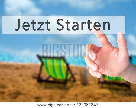 Jetzt Starten (start Now In German)  - Hand Pressing A Button On Blurred Background Concept On Visua