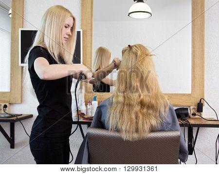 Barber Straightening Client's  Hair