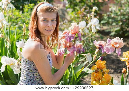 beauty woman with blossom flowers in garden