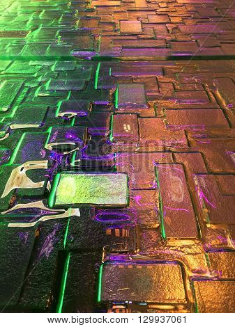 bricks with a reflective glass top surrounded by neon lights.