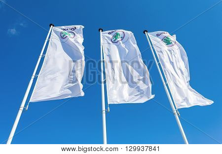 SAMARA RUSSIA - MAY 14 2016: The dealership flags of Skoda over blue sky. Skoda Auto is an automobile manufacturer based in the Czech Republic