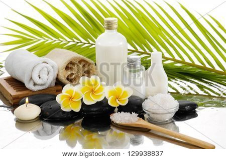 Spa still life with frangipani ,palm and black stone