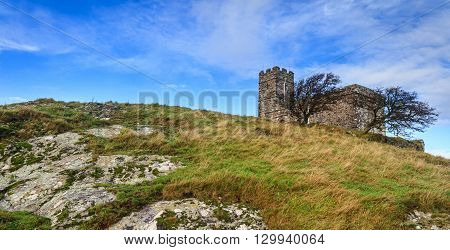 Brentor church perched on a rocky hilltop on Dartmoor National Park in devon