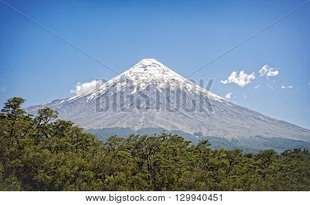 Osorno Volcano, Puerto Montt, Chile. Iconic snow capped landmark rises over 8,700 feet and one of the most active volcanoes in the southern Chilean Andes
