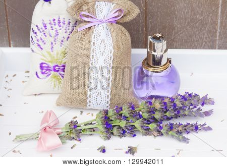 Lavender herbal water in a  bottle, fresh flowers posy and dry in pouches