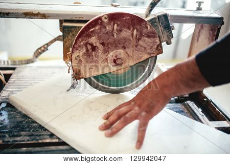 Man Using Circular Saw For Cutting Slate And Marble