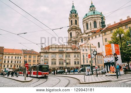 Prague, Czech Republic - October 10, 2014: Movement of old red tram on the street Malostranske namesti