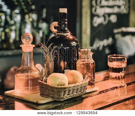 still life tools on the bar bottles in blurred background warm light retro style photo
