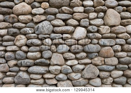 beautiful grey stack stone wall in resort hotel near the beach.