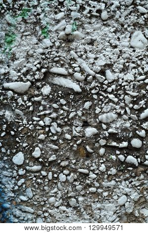 Dirty Grey Concrete Wall With Colored Stones 1