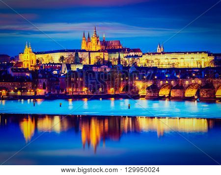 Travel Prague Europe tourism concept background - vintage retro effect filtered hipster style image of view of Charles Bridge and Prague Castle in twilight. Prague, Czech Republic