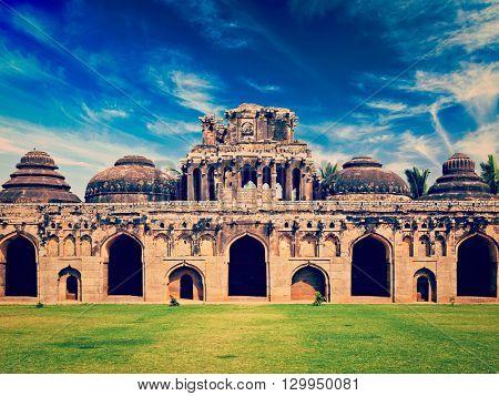 Travel India Karnataka tourism - vintage retro effect filtered hipster style image of Ancient ruins of Elephant Stables, Royal Centre. Hampi, Karnataka, India. Stitched panorama