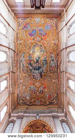 Santarem, Portugal. September 10, 2015: Painted ceiling with an image of Our Lady of Immaculate Conception in the Santarem See Cathedral aka Nossa Senhora da Conceicao Church. 17th century Mannerism.