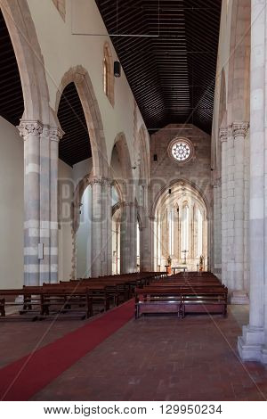 Santarem, Portugal. September 11, 2015: Nave, altar and apse of the Santo Agostinho da Graca church. 14th and 15th century Mendicant and Flamboyant Gothic Architecture.