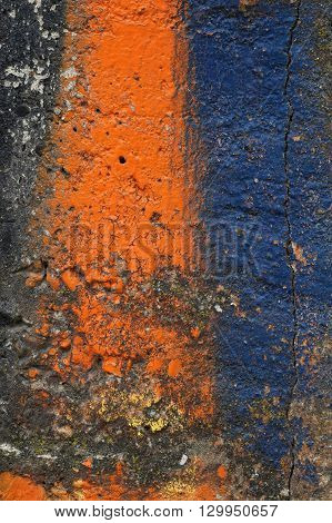 Dirty Concrete Wall With Orange And Blue Paint