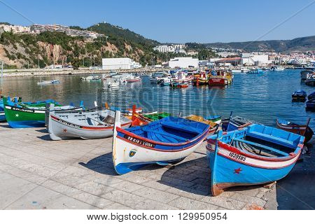 Sesimbra, Portugal. February 22, 2015: Traditional fishing boats (called Aiolas) at the fishing harbour of Sesimbra.