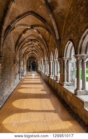 Santarem, Portugal. September 10, 2015: Cloister corridors of the Sao Francisco Convent. 13th century Mendicant Gothic Architecture. Franciscan Religious Order.