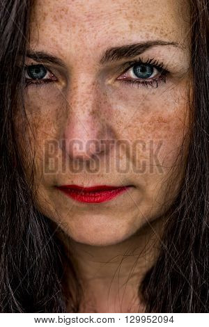 a portrait of a beautiful middle aged woman