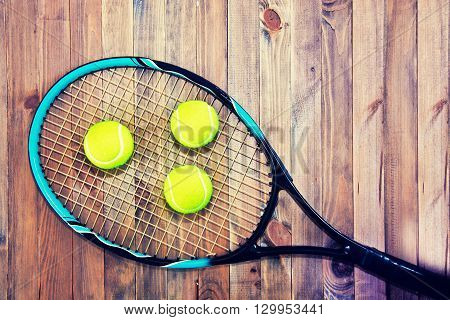 Tennis game. Tennis ball on wooden background. Vintage retro picture.