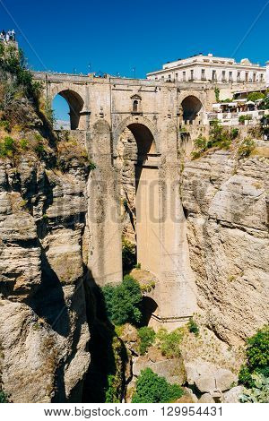 The New Bridge or Puente Nuevo Is The 120-metre-deep Chasm That Carries The Guadalevin River And Divides City Of Ronda, Province Of Malaga, Spain