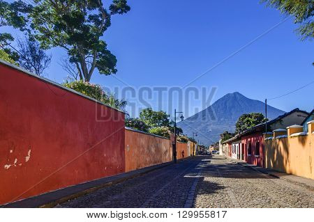 Old colorful painted houses & Agua volcano in colonial city & UNESCO World Heritage Site of Antigua.
