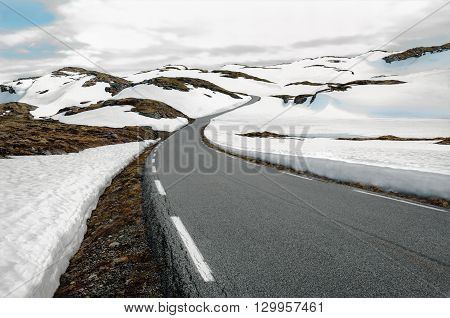 Snowfields Road in Norway:  A narrow road winds through a snowy mountain pass in southwest Norway.