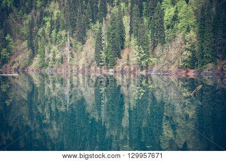 Mountains landscape with a lake view. Caucasus. Abkhazia. Shallow Lake Ritza