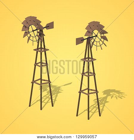 Old wind turbines against the yellow background. 3D lowpoly isometric vector illustration