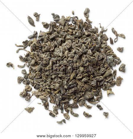 Heap of green gunpowder tea pellets on white background