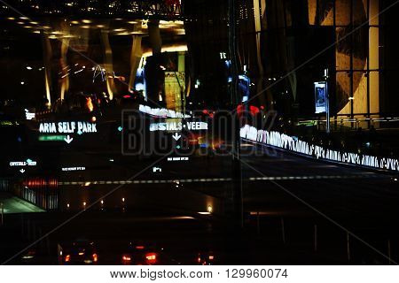 LAS VEGAS, USA - DECEMBER 23: The abstract reflections of traffic lights and advertising of Las Vegas Boulevard in a window on December 23 2015 in Las Vegas.