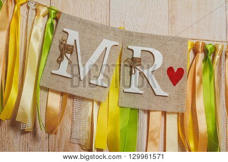 Wedding banner with MR and MRS signs