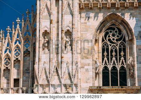Detail of facade of Milan Cathedral or Duomo di Milano is the cathedral church of Milan, Italy.