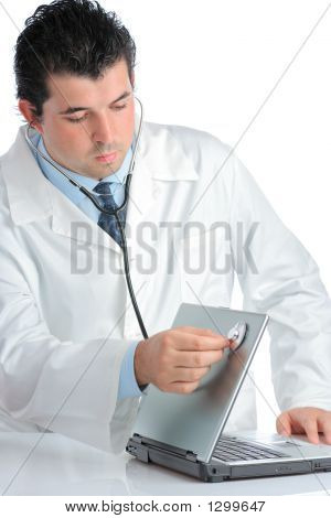 Pc Doctor Examining A Laptop