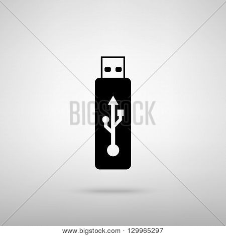 Vector USB flash drive sign. Black with shadow on gray.