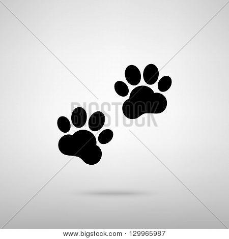 Animal Tracks sign. Black with shadow on gray.
