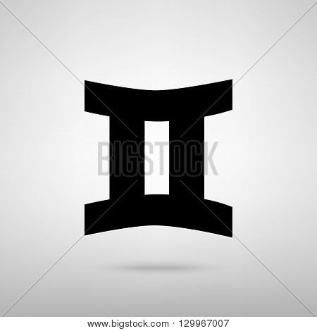 Gemini sign. Black with shadow on gray.