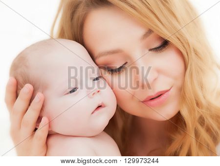 Mother holding and hugging her newborn baby. Motherhood, maternity love concept.