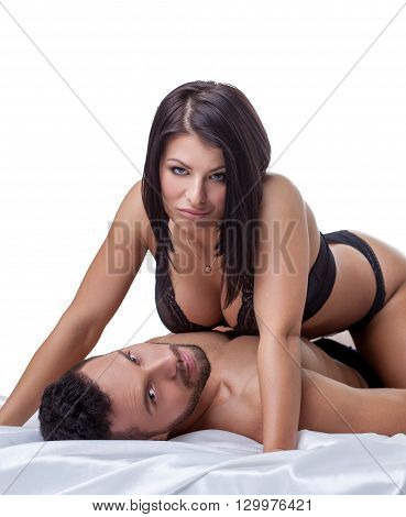 Erotica. Studio photo of hot brunette lies on bearded man