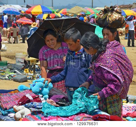 QUETZALTENANGO GUATEMALA april 28 2016 : People sell clothings in Quetzaltenango maket. This native market is the most colorful in Central America