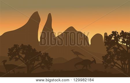 Silhouette of parasaurolophus in fields at the sunrise