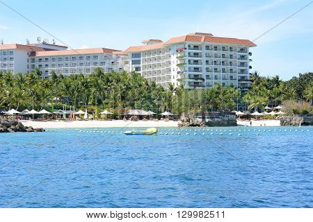 CEBU PHILIPPINES - APRIL 5 2016: Shangri La Mactan Resort and Spa from the water. The luxury resort features a Marine Sanctuary.