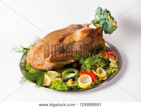 Tray with whole grilled turkey decorated for big dinner