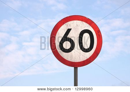 European dirty 60km speed limit traffic sign (blue sky background)