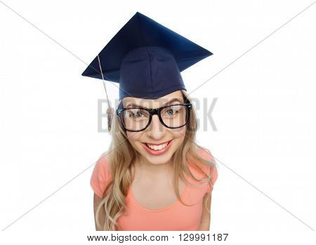 people, graduation and education concept - smiling young student woman in mortarboard and eyeglasses