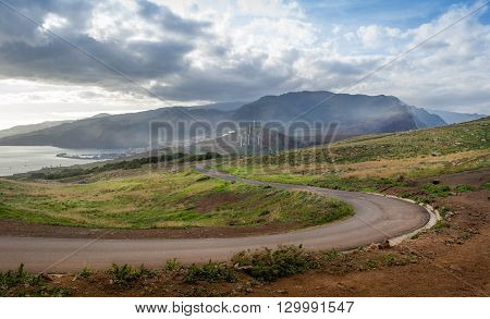 Empty serpentine road from eastern tail of the island to volcanic mountains. Canical, Madeira, Portugal.
