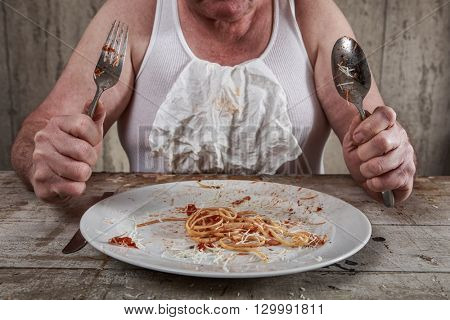 Man at the end of a spaghetti dinner, overeating adult.