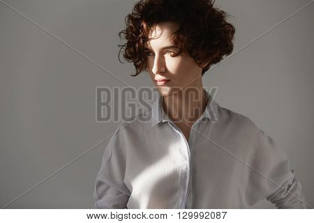Sunny Portrait Of Beautiful Young Woman With Gorgeous Brunette Short Curly Hair, Wearing Trendy Whit