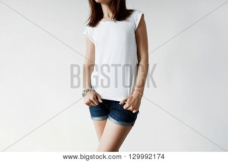Cropped Portrait Of Brunette Teenage Girl Wearing Blue Ripped Jeans And White Loose T-shirt With Cop